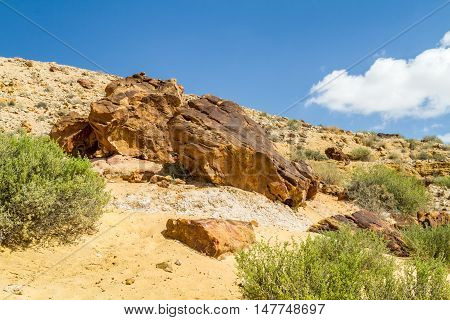 Boulders on the hill in Makhtesh Gadol or Large Crater, nature reserve in Negev desert, Israel