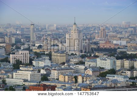 Panoramic view with many roofs, Stalin skyscraper on Kotelnicheskaya quay in morning of Moscow, Russia