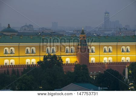 Part of Arsenal building and red Kremlin wall with illimination at night in Moscow, Russia poster