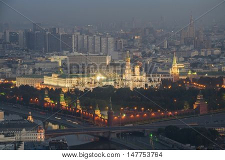 Illuminated Kremlin towers, Ivan Great belltower, bridge in center of Moscow, Russia at night