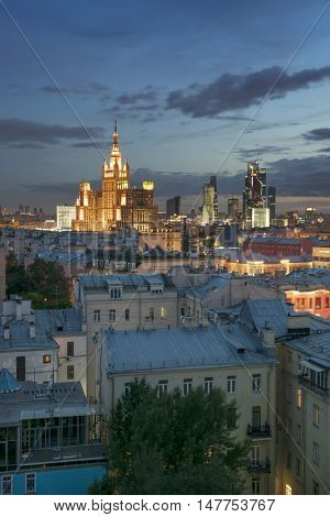 Roofs and residential building on square Kudrinskaya (Stalin skyscraper) at night in Moscow, Russia