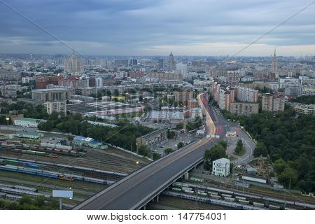 Railroad with trains and modern highway in Moscow, Russia, 1905 street, view from apartment complex House on Begovaya