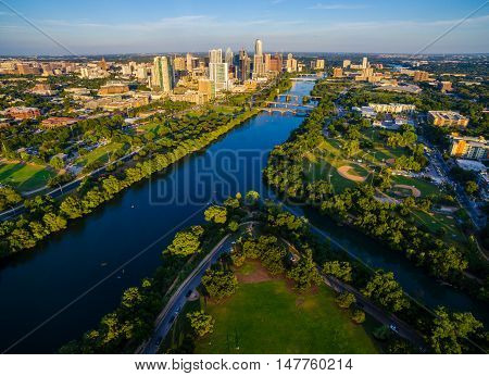 Aerial Shot Above Zilker Park Austin Texas Central Capital Cities Skyline Cityscape with Blue Colorado River or Town Lake bridges and the entire City on a nice summer day