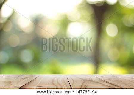 Empty wood table with backdrop blurred nature background, Can be used for display your product