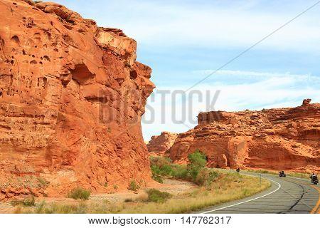 Motorcycles traveling through Glen Canyon National Park, Utah