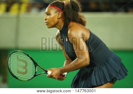 RIO DE JANEIRO, BRAZIL - AUGUST 8, 2016: Olympic champions Serena Williams  of United States in action during singles round two match of the Rio 2016 Olympic Games at the Olympic Tennis Centre