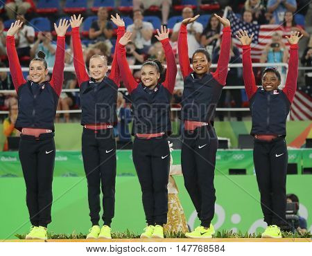 RIO DE JANEIRO, BRAZIL - AUGUST 9, 2016: Team USA women's team all-around gymnastics winners at Rio 2016 Olympic Games Raisman (L), Kocian, Hernandez, Douglas and Simone Biles during medal ceremony