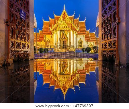 Wat Benchamabophit in Bangkok at twilight time with reflection on the water after hard raining Bangkok Thailand
