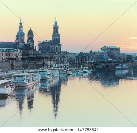 Old Dresden at sunset. Augustus Bridge and historical landmarks glowing in evening light