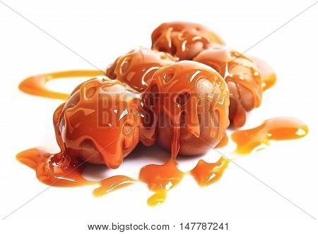 Caramel candies and caramel topping isolated on a white background.
