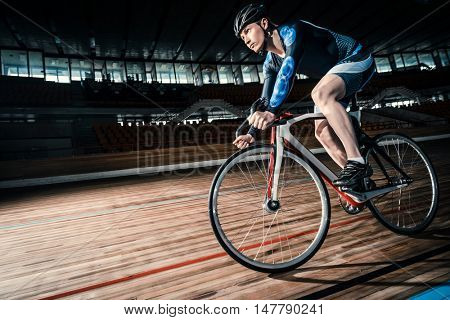 Racing cyclist on a cycle track