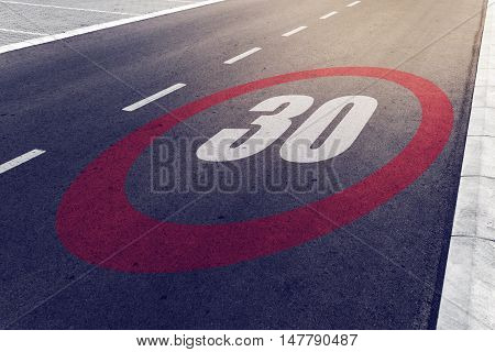 30 kmph or mph driving speed limit sign on highway road safety and preventing traffic accident concept.