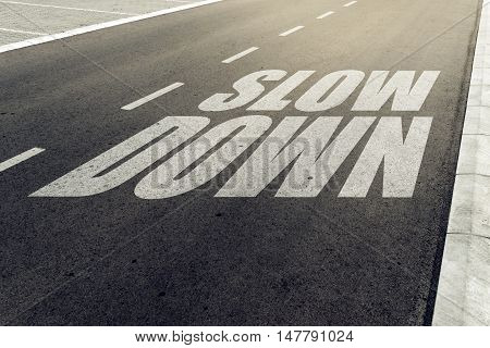 Slow down speed limit sign on highway road safety and preventing traffic accident concept.