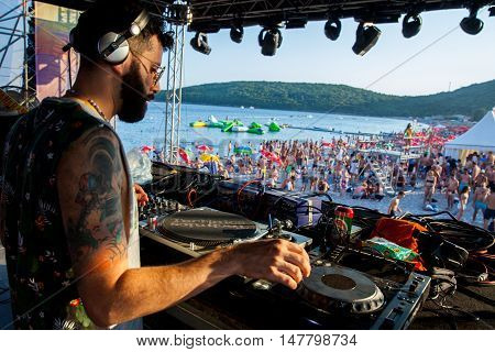 BUDVA- JULY 16 : DJ SESSION AND CROWD ON THE DANCE PARADISO STAGEAT SEA DANCE FESTIVAL 2015 MUSIC FESTIVAL JULY 16 2015 IN BUDVA JAZ BEACH MONTENEGRO