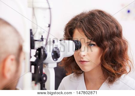young female optometrist working in studio lab