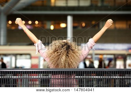 Carefree Woman With Arms Outstretched