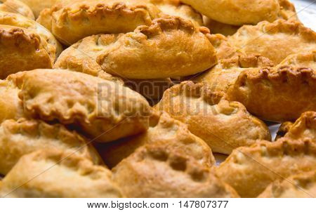 a few small fresh pies with golden crust.