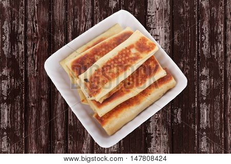 russian food - pancake with various fillings served over old style wooden table