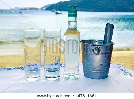 greek ouzo at a tavern in front of the sea