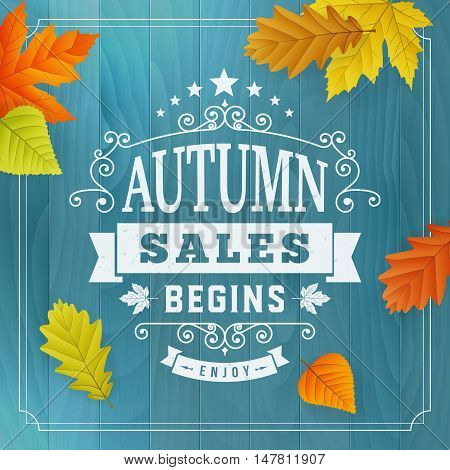 Seasonal autumn business sales advertisement on blue wood plankbackground with leafs. Editable vector isolated object.