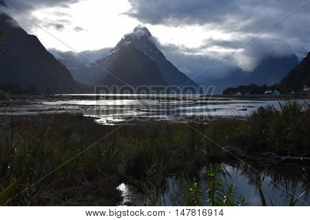 Milford Sound at low tide in winter sunset. Mitre Peak (Fiordland New Zealand). 8th wonder of the world.