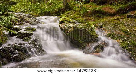 Weisse Regen waterfall near moraine lake Kleiner Arbersee in Bavarian forest Germany