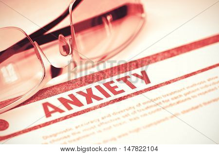 Anxiety - Medical Concept on Red Background with Blurred Text and Composition of Specs. Anxiety - Printed Diagnosis with Blurred Text on Red Background with Spectacles. Medicine Concept. 3D Rendering.