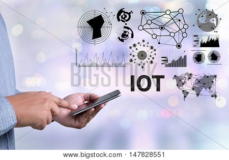 Iot Hands At Work With Financial Reports And A Laptop With Other Objects Around, Coffee, Top View,bu