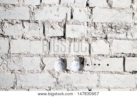 Texture of a gray brick wall during overhaul
