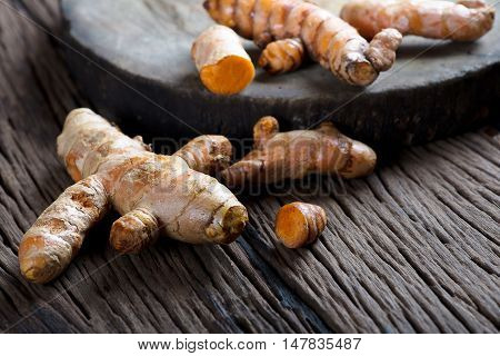 Turmeric on grunge wooden background. Turmeric background.