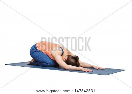 Beautiful sporty fit yogini woman practices yoga asana balasana (child's pose) - resting pose or counter asana for many asanas in studio isolated on white