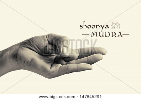 B/W image of woman hand in Shoonya mudra. Gesture is isolated on toned background.