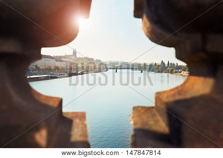 Amazing sunrise in the city. The view over the balustrade of the bridge. Prague Czech Republic.