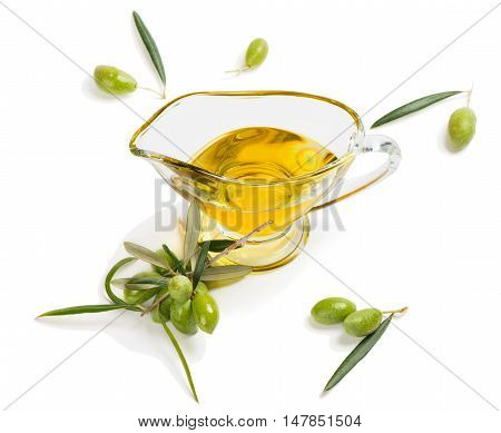 Extra virgin olive oil and green olives with leaves isolated on white background.