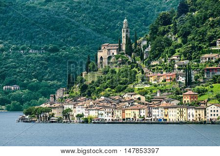 The Ceresio Lake (Ticino Switzerland)) landscape at summer. Church of Santa Maria del Sasso seen from Brusino Arsizio