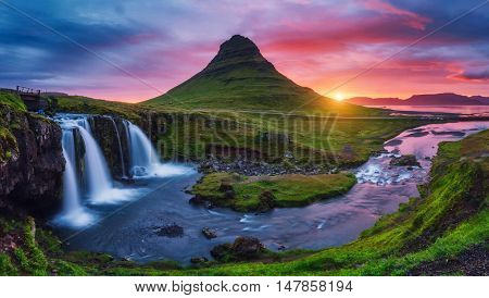 Majestic evening with Kirkjufell volcano the coast of Snaefellsnes peninsula. Dramatic and picturesque scene. Location famous place Kirkjufellsfoss waterfall, Iceland, Europe. Beauty world.
