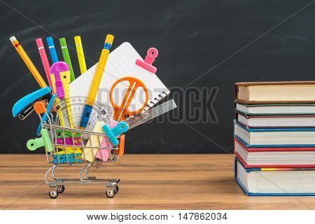 Take School Supplies In Shopping Cart With Textbook