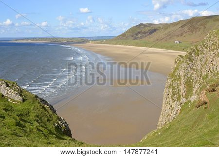 Rhossili Bay with distant people on beach. Gower Peninsular Wales UK