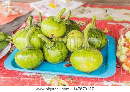 Young fresh pumpkin for sale at local Thai market Northeast of Thailand