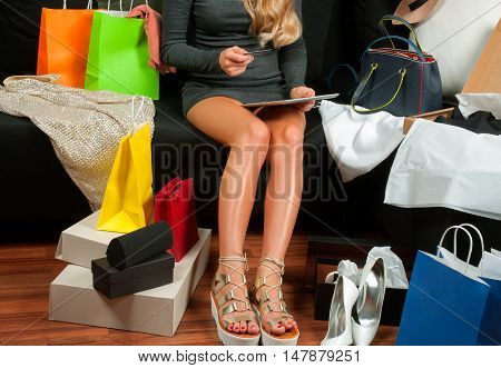 Shopping and fashion images. Woman's legs and shopping bags