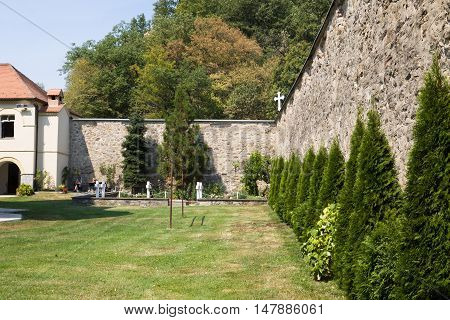 JAZAK, SERBIA - AUGUST 31, 2012: The monastic wall in the orthodox monastery Jazak in Serbia. The Jazak monastery is located in the northern Serbia in the province of Vojvodina. The monastery was founded in 1736.