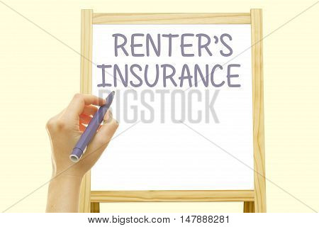 Woman hand writing RENTER'S INSURANCE on a transparent wipe board.