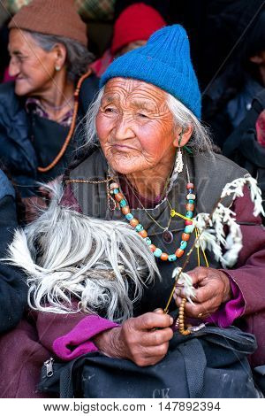 LEH, JAMMU AND KASHMIR, INDIA - JUNE 17, 2012: Ladakhi woman in national clothes poses for a photo during Yuru Kabgyat festival.