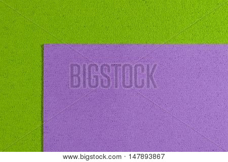 Eva foam ethylene vinyl acetate light purple surface on apple green sponge plush background