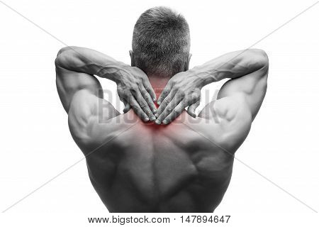 Middle aged man with pain in neck muscular male body studio isolated shot on white background with red dot black and white photography
