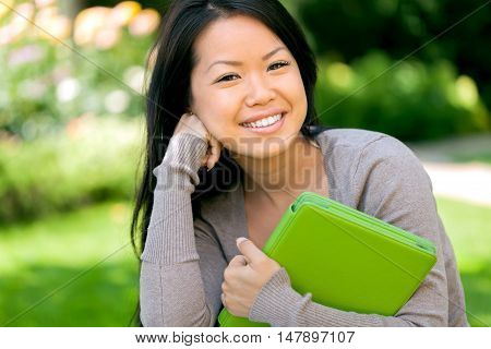 Portrait of a Student Woman in the Park