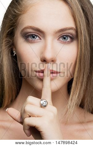 Closeup of Woman with Finger on Lips