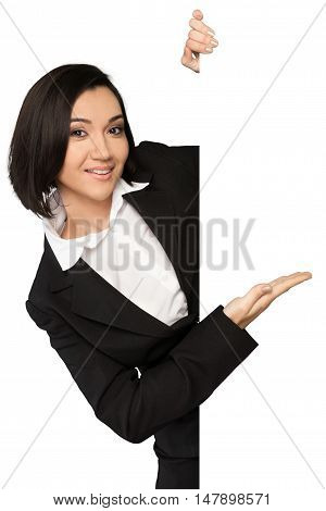 Portrait of a Businesswoman Behind Blank Wall Showing Empty Space