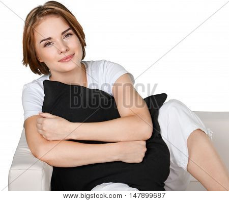 Portrait of a Young Woman with a Pillow on a Couch