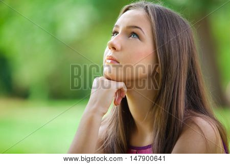Portrait of a Young Woman Thinking / Looking Up